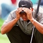 Tiger Woods looking at a putt